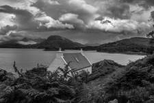 Torridon red house Photo by Richard Barwick This photo reminded me of the traditional butt and ben somewhere in the wild Scottish Highlands.  For me the clouds give this photo that moody atmosphere and make this photo.